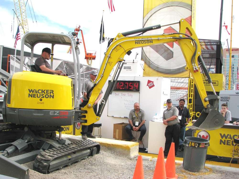 Jonathan Smith of Liebherr Cranes, Newport News, Va., makes a pretty good run at the Wacker Neuson mini-excavator competition.