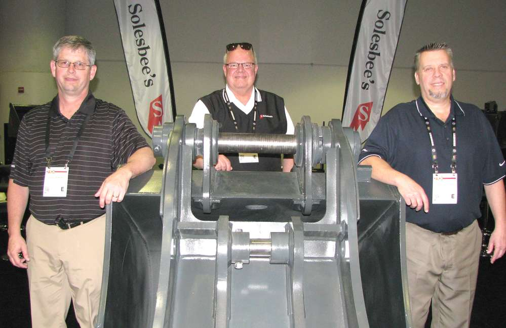 (L-R): Solesbees's David Jenkins, Chuck Liston and Lane Scroggins kept extremely busy promoting their line of attachments — a variety for virtually any earthmoving or lifting machine on the market.