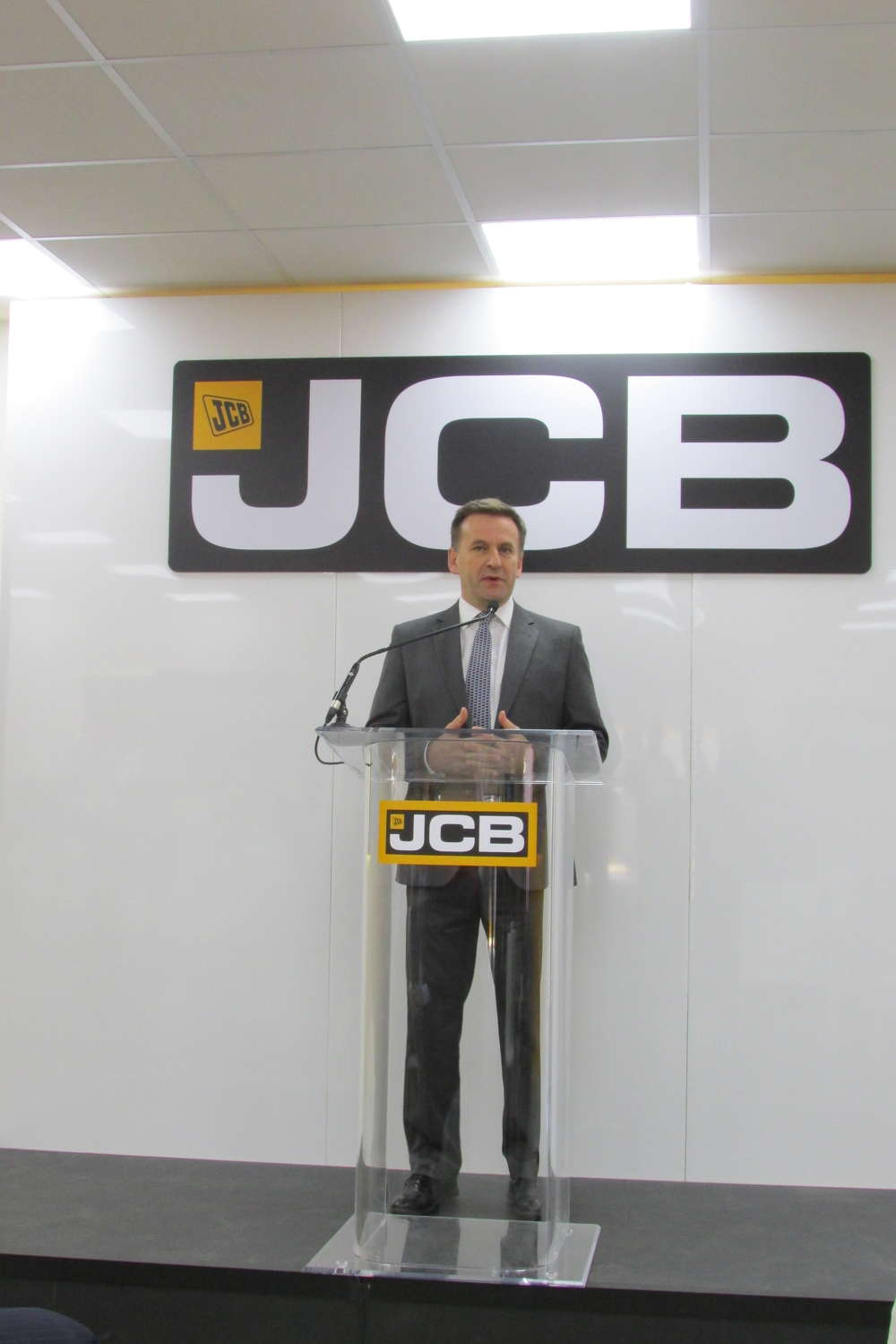 Graeme MacDonald, CEO of JCB, addresses media during the company's press conference in the Gold Lot.