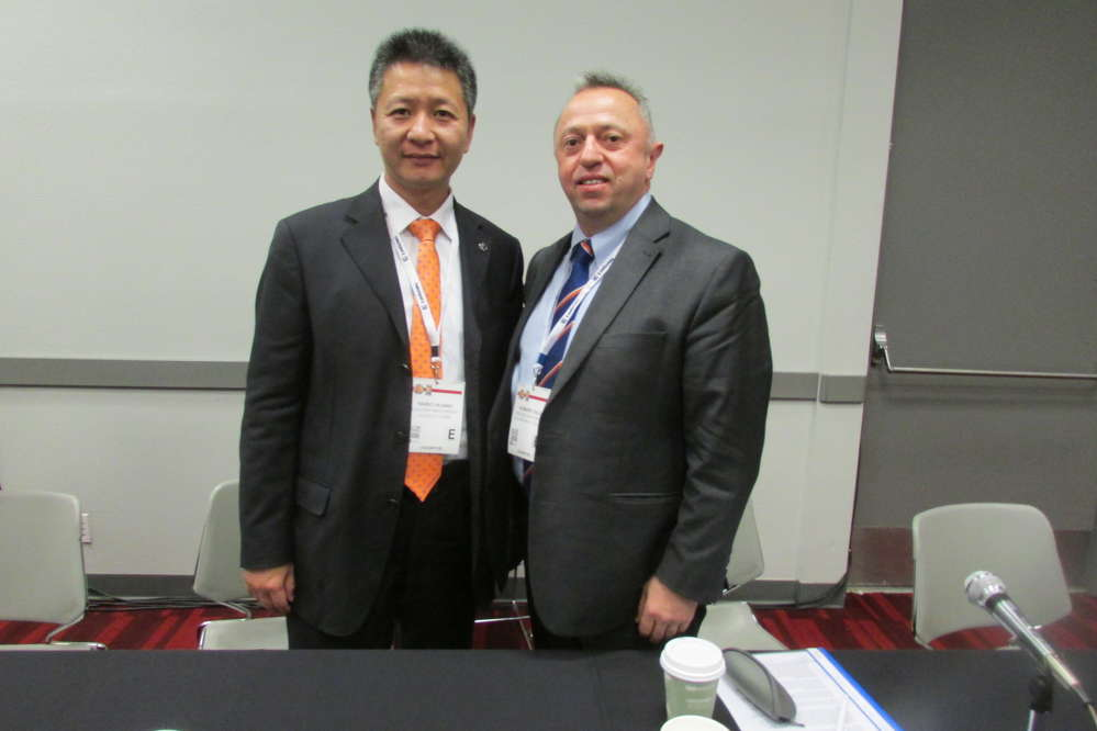 Huang Haibo (L), president, and Li Dongchun, chairman, both of LiuGong, pose for a photo following their company's press conference at ConExpo.