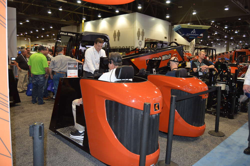 ConExpo guests try out the Ditch Witch virtual reality simulator.
