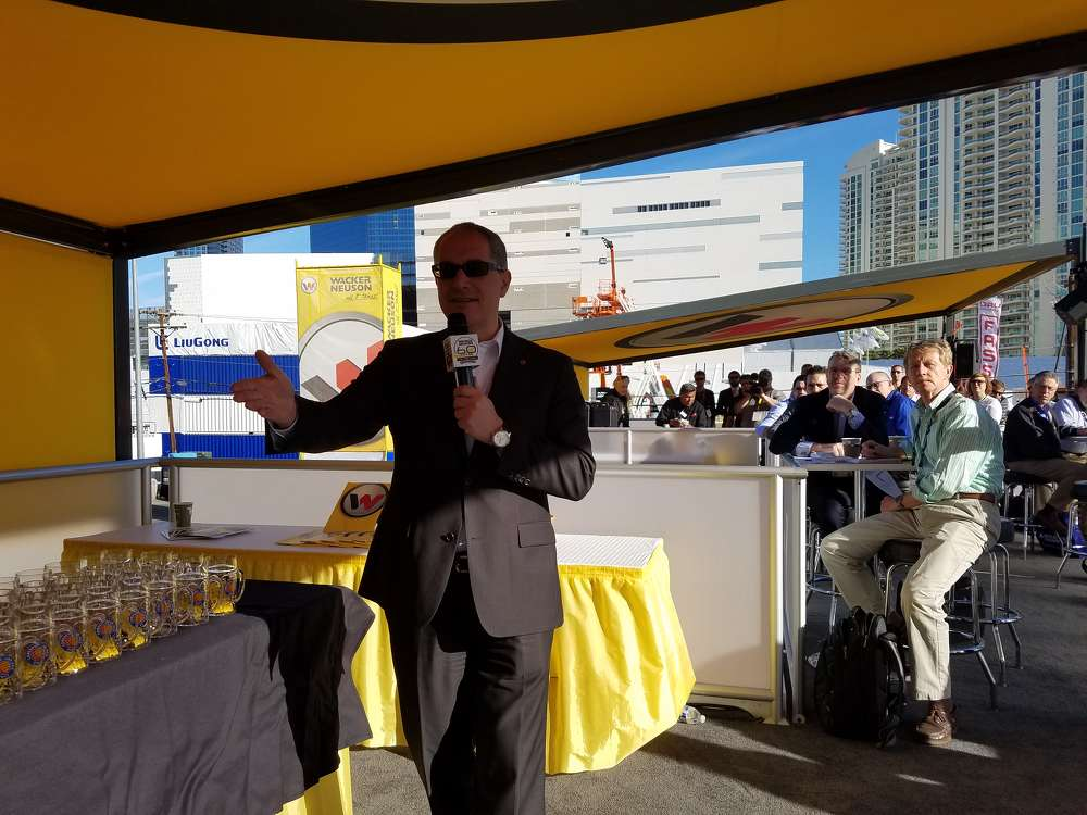 Cem Peksaglam, chairman and CEO of Wacker Neuson, welcomes the media to its press event.