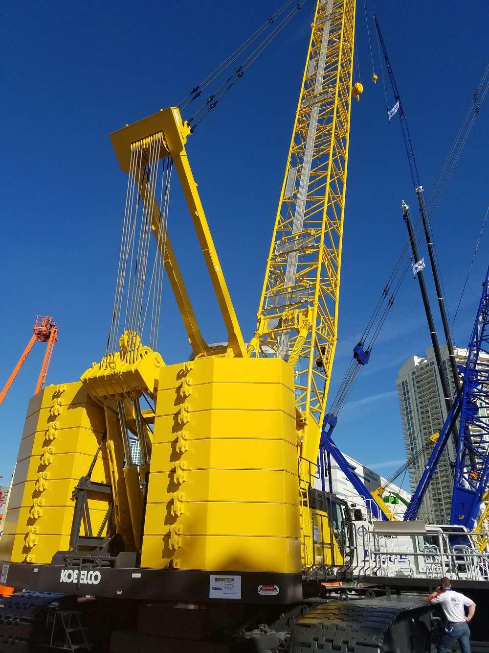 Kobelco had towering yellow cranes at its outdoor exhibit.