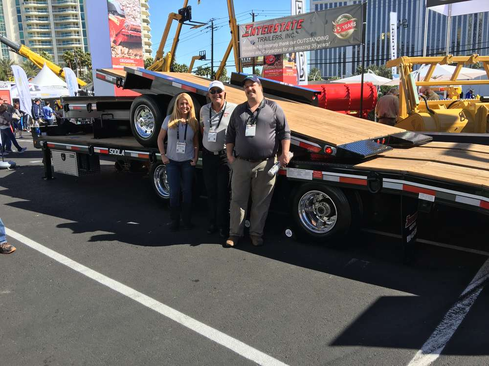 (nterstate Trailers new 50-ton trailer features a new airbrake ramp system that is powered from the air system on the truck. Discussing this are Amanda and Steve Flowers of Interstate Trailers, and Joshua Laware of Laware Construction Inc., Plattsburgh, N.Y.