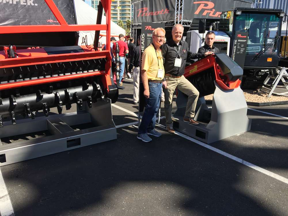 Prinoth displayed its new cutting head systems. Pictured here (L-R) are Paul Harmer of Richardson Services in Conway, S.C.; and Michel Van Wees and Kai Fetscher, both of Prinoth in Quebec, Canada.