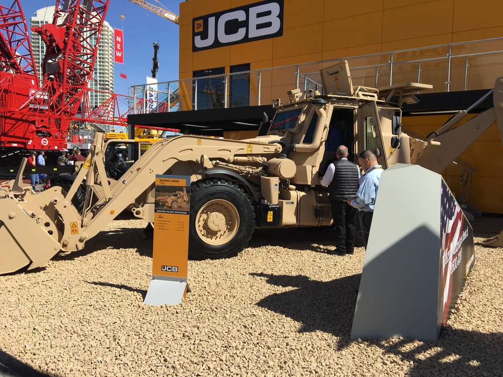 The JCB HMEE backhoeloader is a dedicated military machine that can travel up to 60 mph and dig down 21 ft.