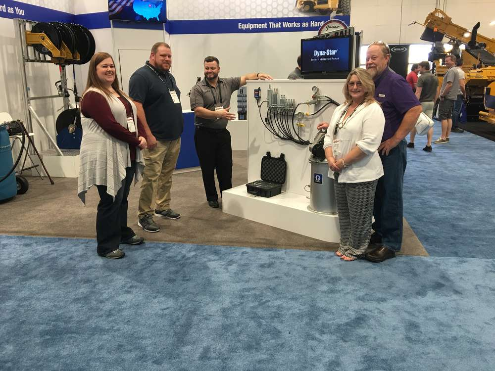 At the Graco Inc. Lubrication Equipment Division booth are (L-R) Shannon Troglauer and Dustin Boling, both of FQS/Franks Quality Services in Lexington, S.C.; Gabe Elmhorst of Graco; and Robin and Frank Troglauer.