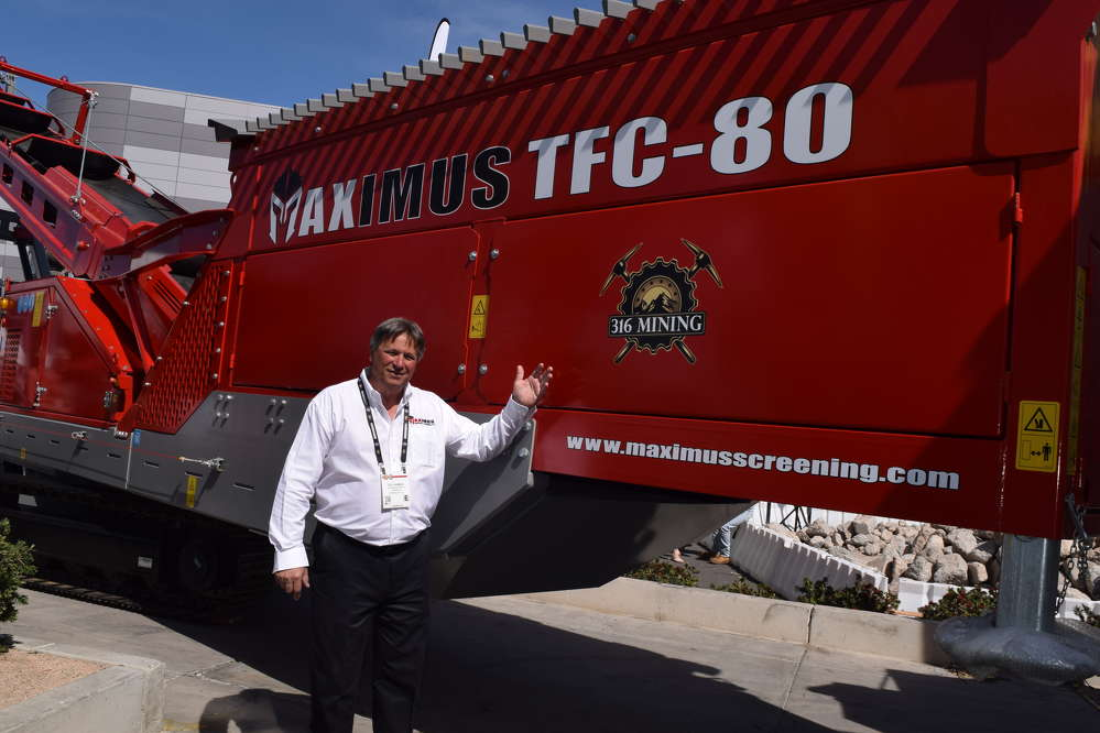 Stu Gamble, president of Maximus, works the crowds at his display at ConExpo, Here, he stands in front of his Maximus TFC-80, ready to be sold.