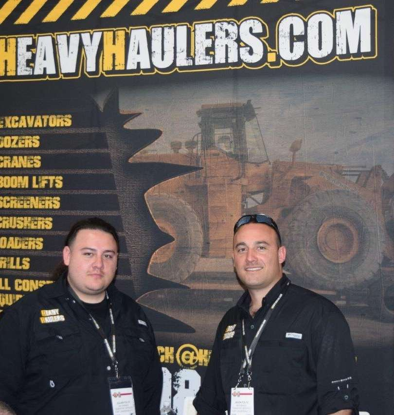 Julian Foltz (L) and Jason Foltz, both of HEAVYHAULERS.COM, and their team, were busy telling prospects about their products and services during ConExpo