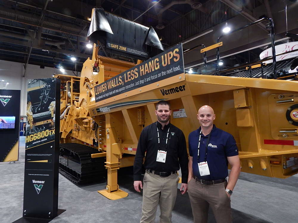 A new product unveiled during ConExpo, the Vermeer HG6000TX tracked horizontal grinder is designed for wood waste, land clearing, municipal waste processing, tree service, logging and urban construction. Seen here are Ted Dirkkx (L), solutions specialist for recycling and forestry, Vermeer, and Andrew Knudson, of RDO Equipment, a Vermeer dealer out of the company's Fontana, Calif. location.