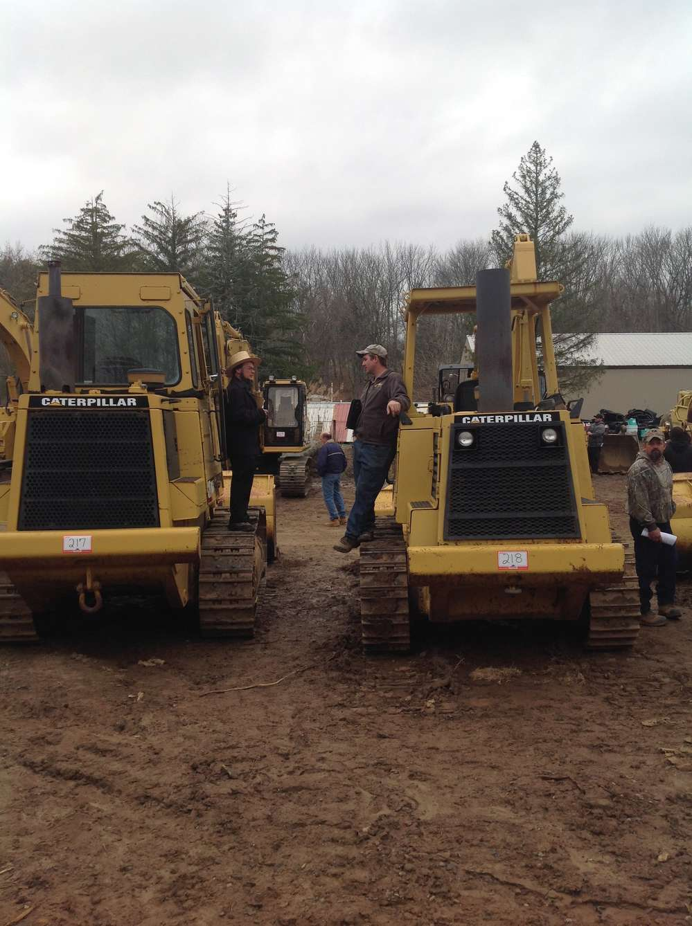 Gideon Stoltzfus (L) and Aaron Hoover, A&A Enterprises, Denver, Pa., discuss auction strategy on these two Cat dozers.