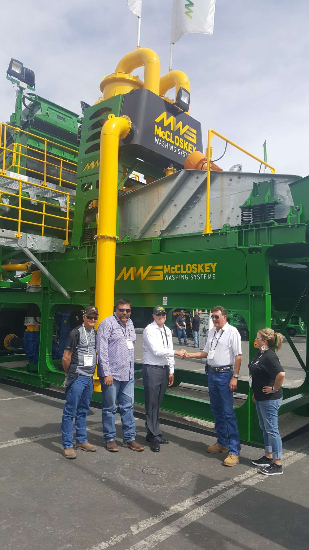 Excel Machinery Ltd & McCloskey Washing Systems shaking hands on dealership agreement. Left to Right: David Timmons, Charles Romero, Craig Rautiola (MWS), Matt Garth & Jenifer Payne