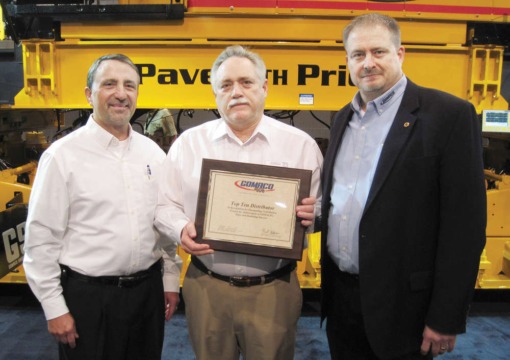 Fabick CAT From left: Bob Leonard, GOMACO United States and Canada Sales Manager; Tom Held, Fabick CAT; and Kent Godbersen, GOMACO Vice President of Worldwide Sales and Marketing.