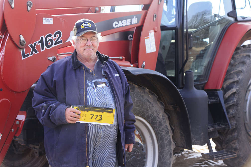Larry Ponto of Ogilvie, Minn., attends the auction.