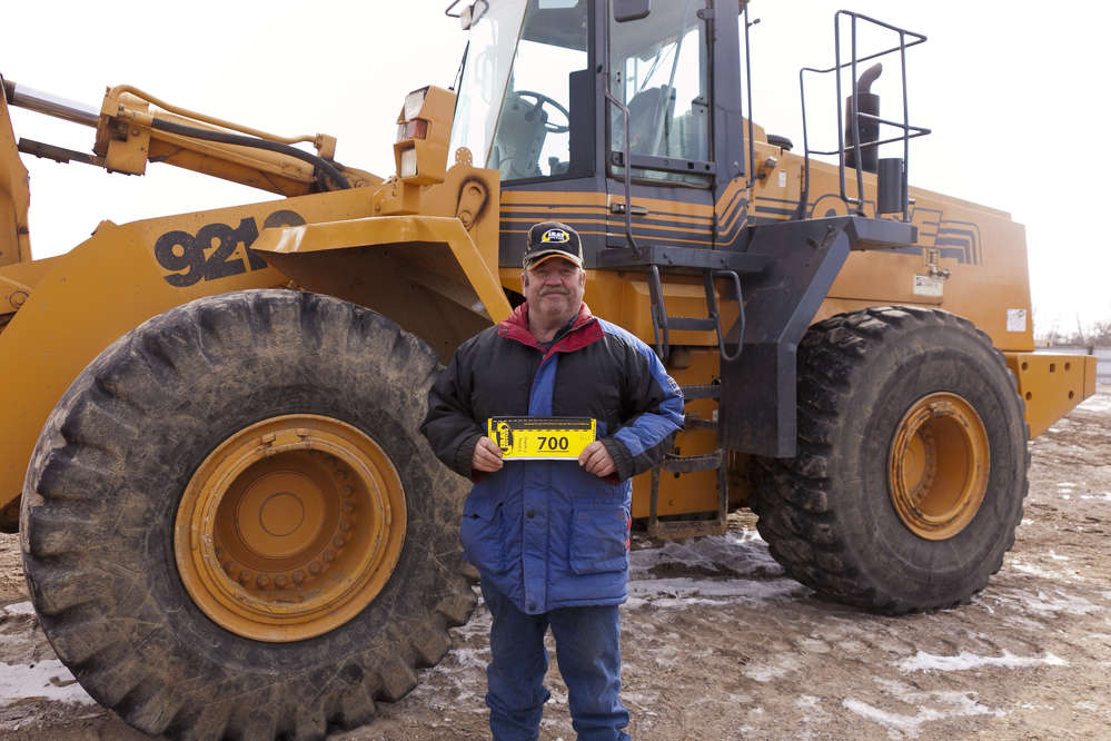 Richard Dumprope, Fort Ripley, Minn., considers bidding on this 2000 Case 921C wheel loader.
