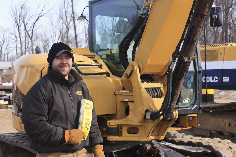 Robert Knopik of Little Falls, Minn. — pictured in front of the selection of excavators and mini-excavators featured in Ring 1.