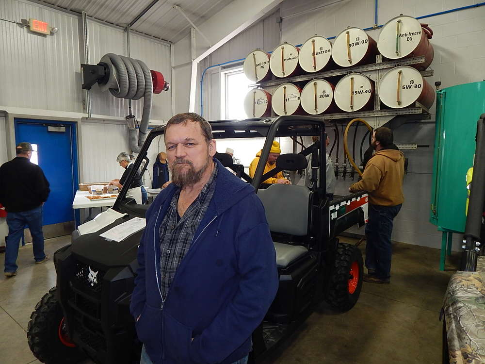 Tim Sicheneder, a hay farmer from New Germany, Minn., takes a look at this Bobcat 3400 utility vehicle.
