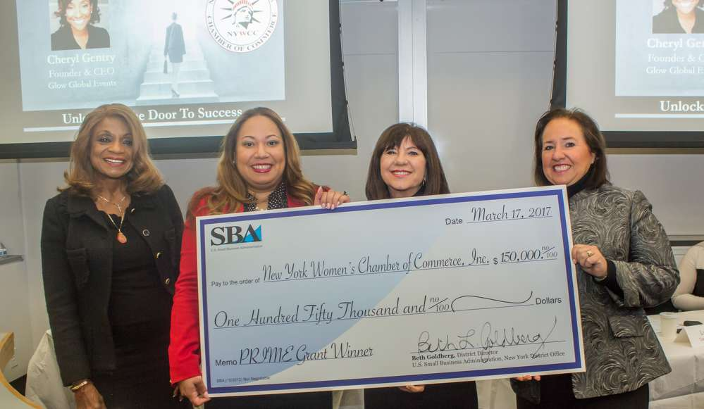 Accepting a generous check for the NYWCC from the US Small Business Administration are, L-R: Eugenia Foxworth, owner, Foxworth Realty; Quenia Abreu, president and CEO, NY Women's Chamber of Commerce; Lina Gottesman, chair, NYWCC and president and CEO, Altus Metal, Marble and Wood; Beth Goldberg, NY District Director, US Small Business Administration. Photo by John Barragan.