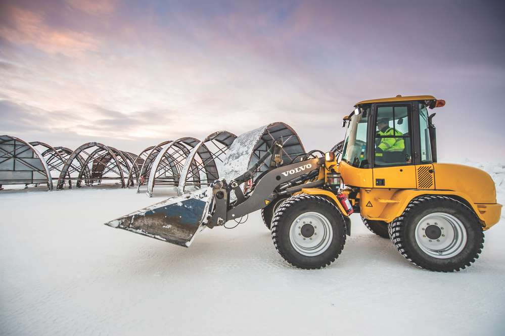 A Volvo wheel loader is used to harvest ice, move snow and ice blocks used for building, as well as clear snow.