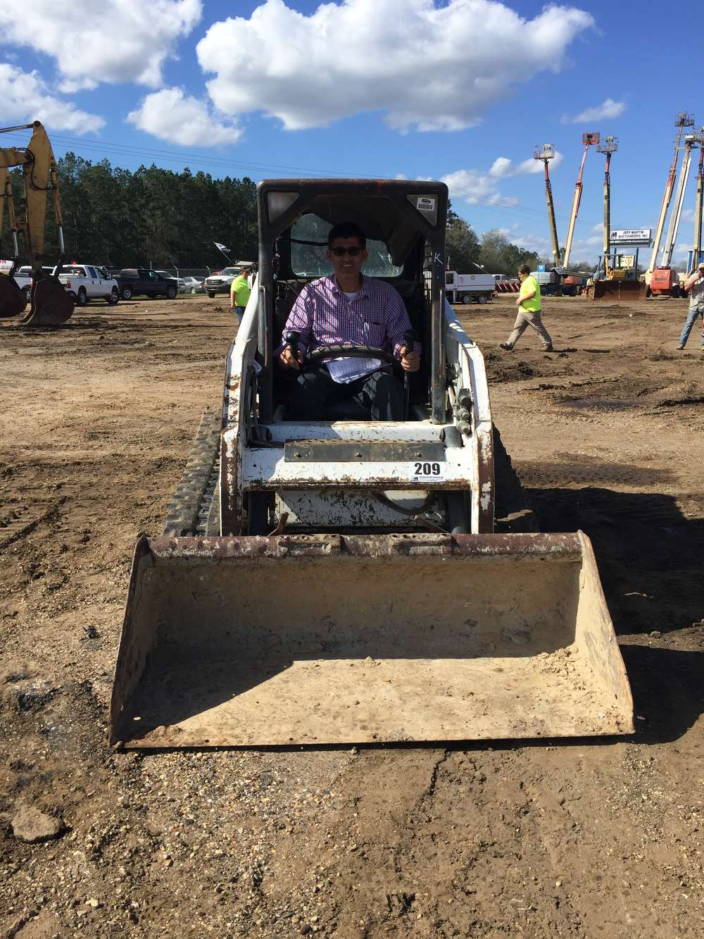 Mohamad Safawi from Atlanta, Ga., inspects this 2007 Bobcat T180 multi-terrain loader.