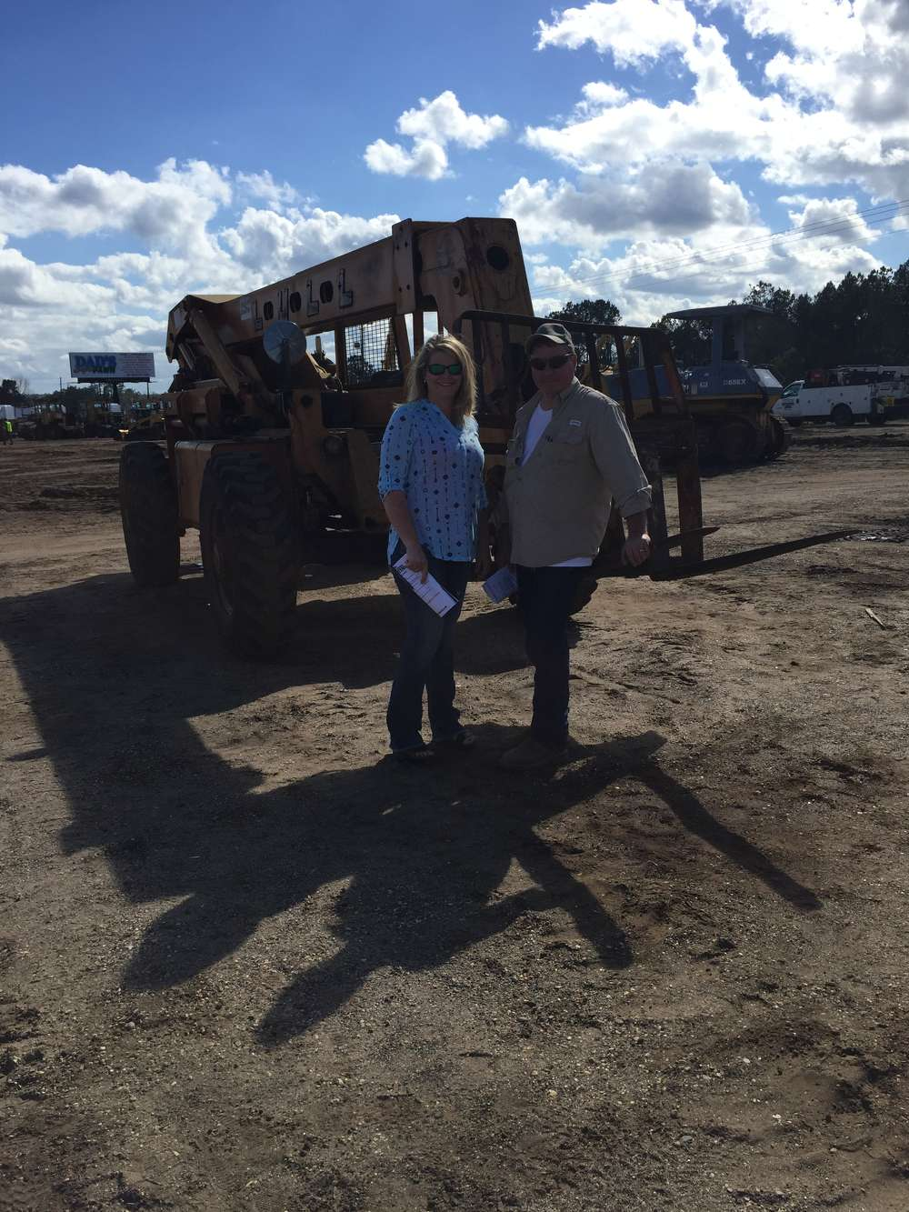 Doshia and Bryant Tanner of Tanner Equipment in Wiggins, Miss., shop the selection of construction equipment being sold on day one of the auction.