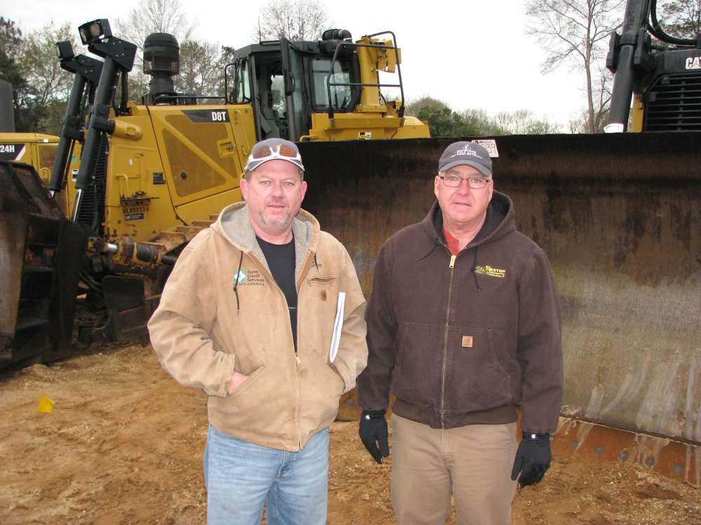 Scott Crowe (L) of Crowe Equipment, Jasonville, Ind., and Wally Sexton of Sexton Equipment Inc. based in Santa Claus, Ind., consider bidding on this Cat D8T dozers.