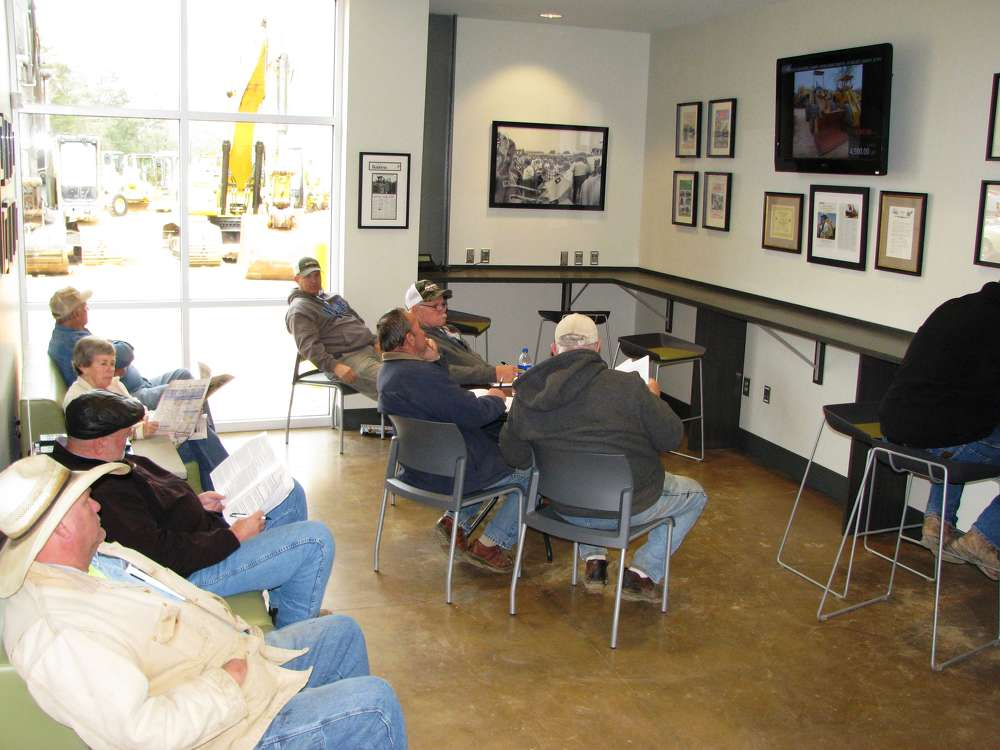 The Wi-Fi lounge area of the newly renovated JM Wood facility offers buyers a new place to grab a seat and monitor the machine sales.