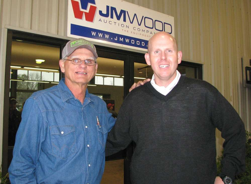 Tommy Burke (L), superintendent of Central Contracting, the general contractor of the building expansion from Wetumpka, Ala., joins JM Wood's Russ Wood for the grand re-opening event.
