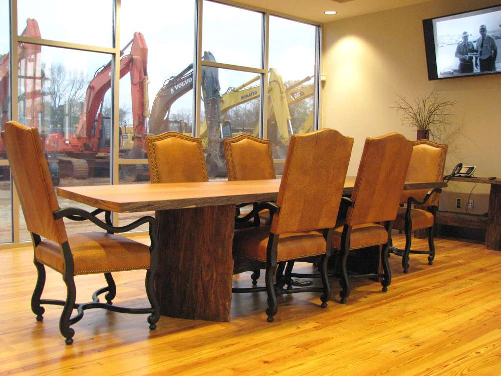 A rustic conference room overlooks the equipment yard and provides a space for quiet meetings.