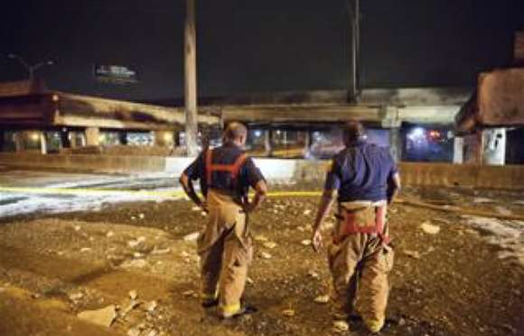 The cause of the fire was still undetermined on Thursday night as firefighters survey the aftermath. David Goldman / AP