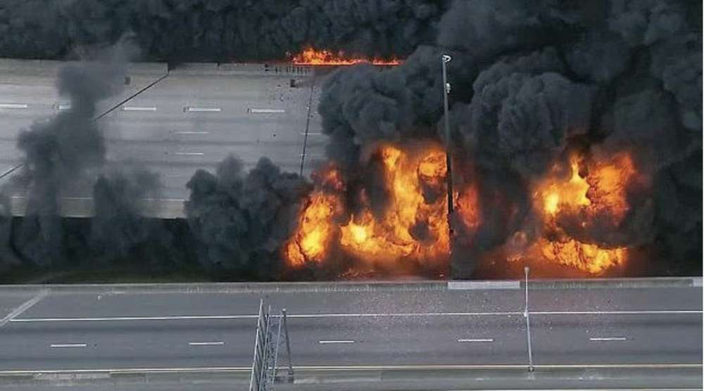 Flames erupt from the underpass on Interstate 85 on Thursday, March 30. Photo via NBC News Channel.