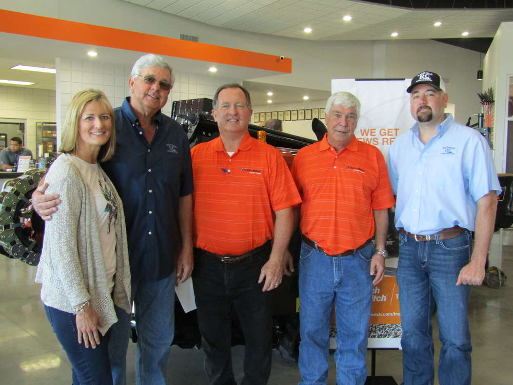 (L-R): Regina and James Raymond, owners of Raymond Construction, talk with Bart Young, GM of Ditch Witch of Texas; Paul Knuckley, owner of Ditch Witch of East Texas; and J.B. Raymond. The Raymonds are long-time Ditch Witch owner