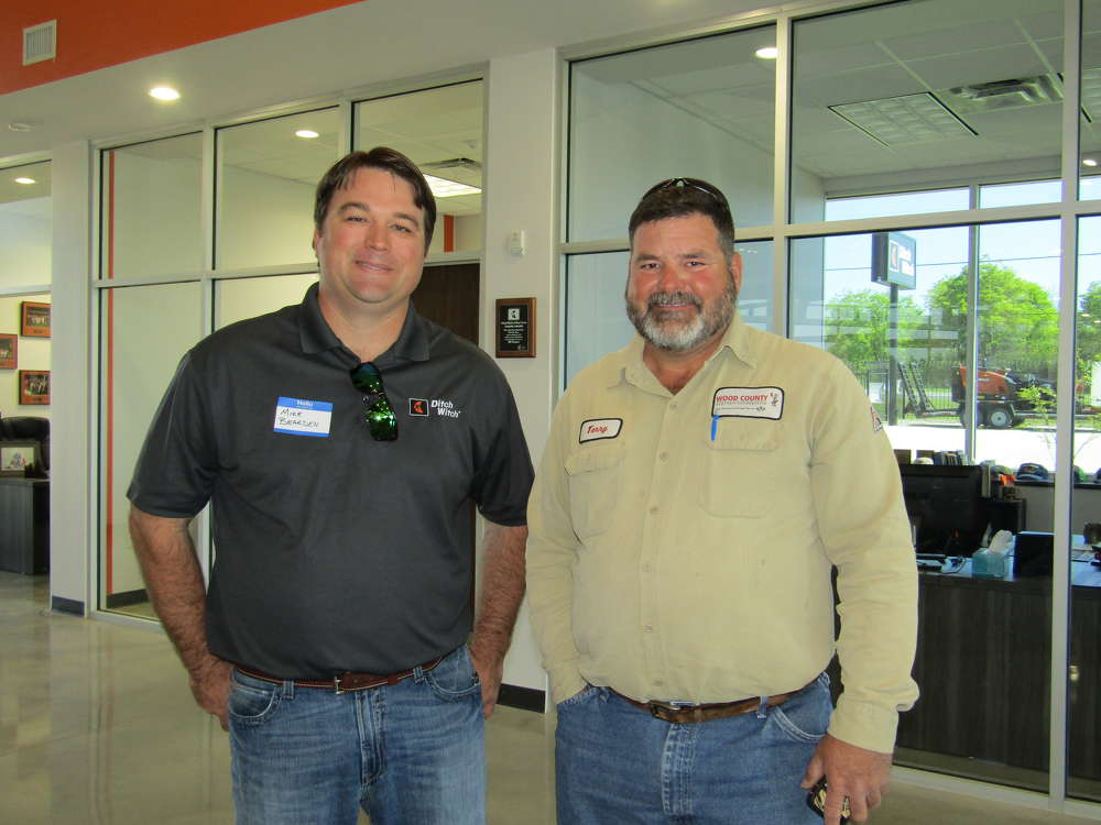 Mike Bearden (L), Fort Worth representative of Witch Equipment Co., and Terry Hayley of Wood County Electric Cooperative, check out the new facility.