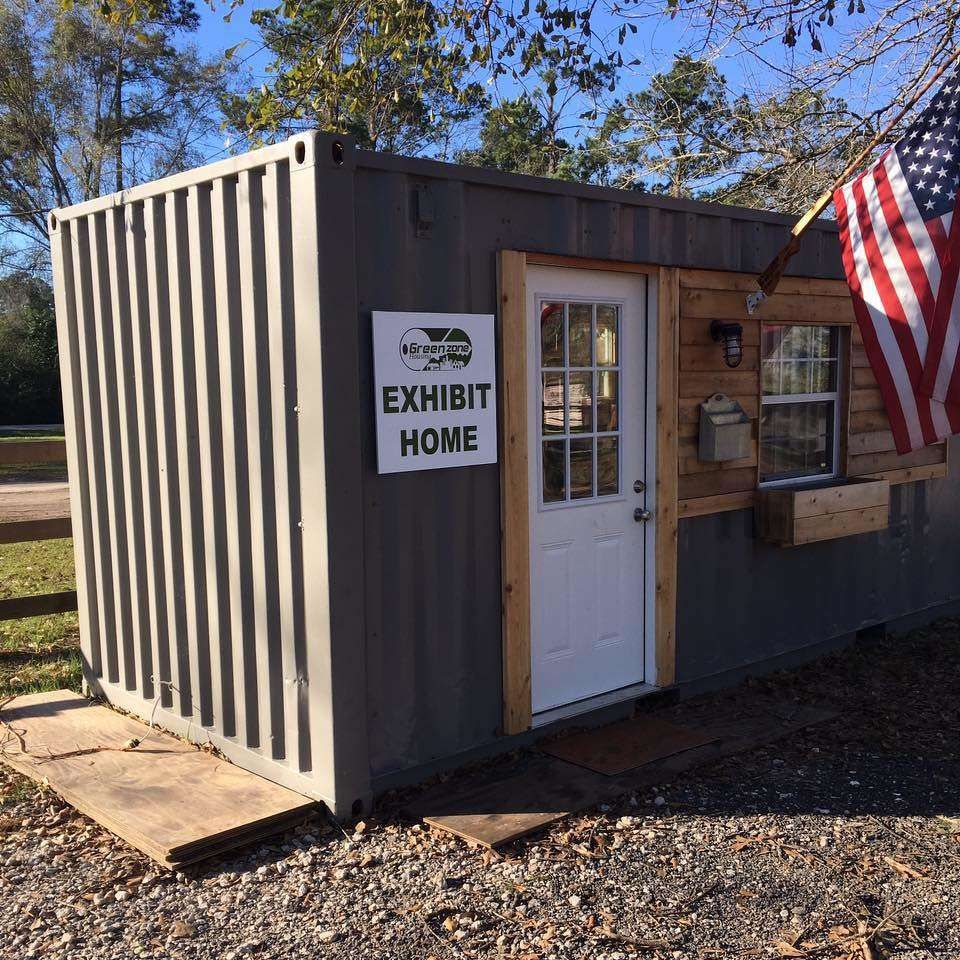 Green Zone Housing photo. Scores of volunteers will modify the container with things like insulation, air conditioning, electrical outlets, kitchen appliances and a shower and toilet. Then the keys will be given to a military veteran in need of a home.