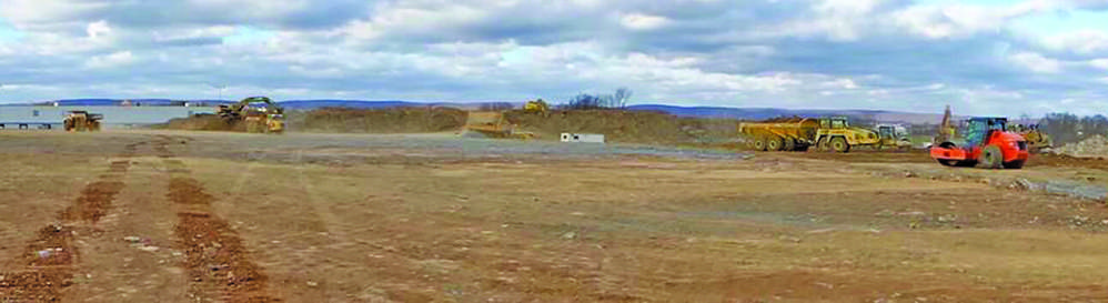 Schlouch crews are busy on a section of a 201.7-acre site being prepared for a 1,117,000 sq. ft. warehouse for Penntex Construction in Cumberland County, Pa