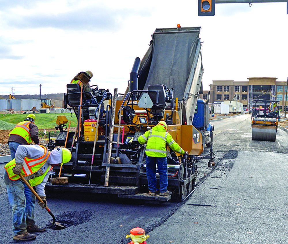 Schlouch paving crew works on the entrance drive for Life Time Fitness Inc. in King of Prussia, Pa. The two-building site will be completed by the spring 2017.