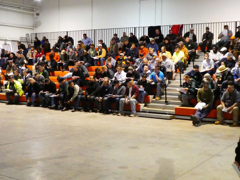 The virtual ramp grandstands were packed with bidders.