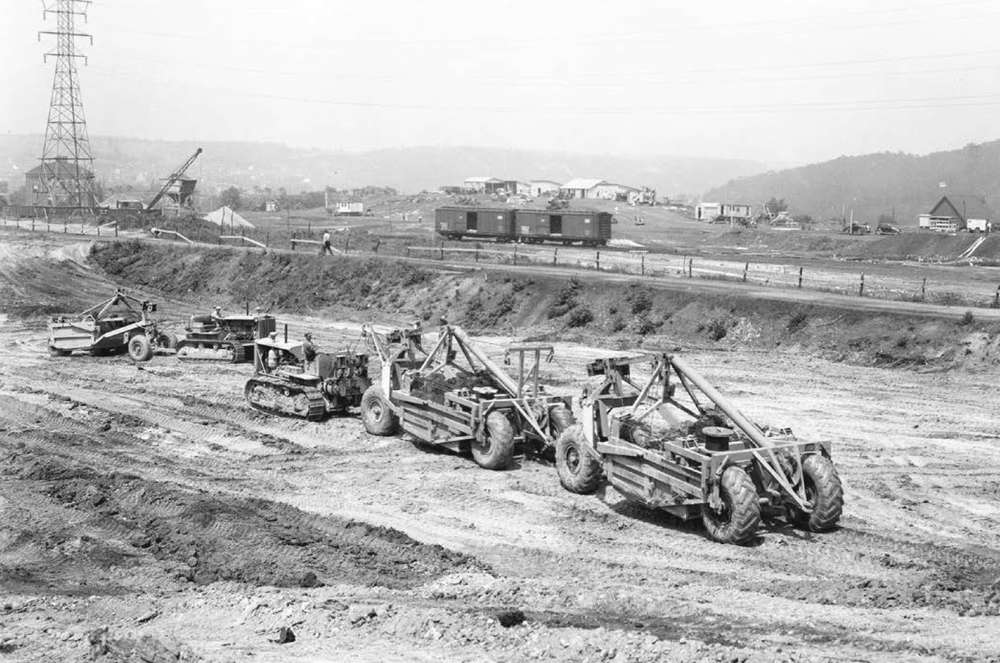 HCEA photo The LeTourneau Carryall pans are shown operated in tandem and singly, drawn by Caterpillar RD-8 tractors, ca. 1937.