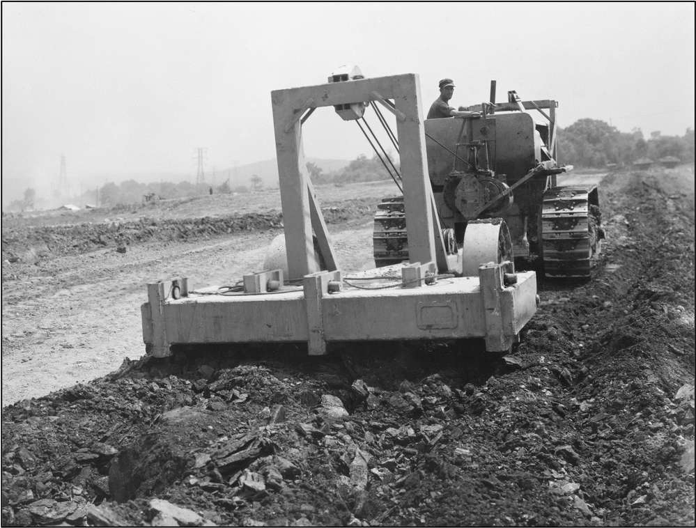 Caterpillar photo A Caterpillar RD-8 diesel tractor pulls a LeTourneau Rooter ripping laminated shale. Approximately 40 percent of the excavation on the project was rock
