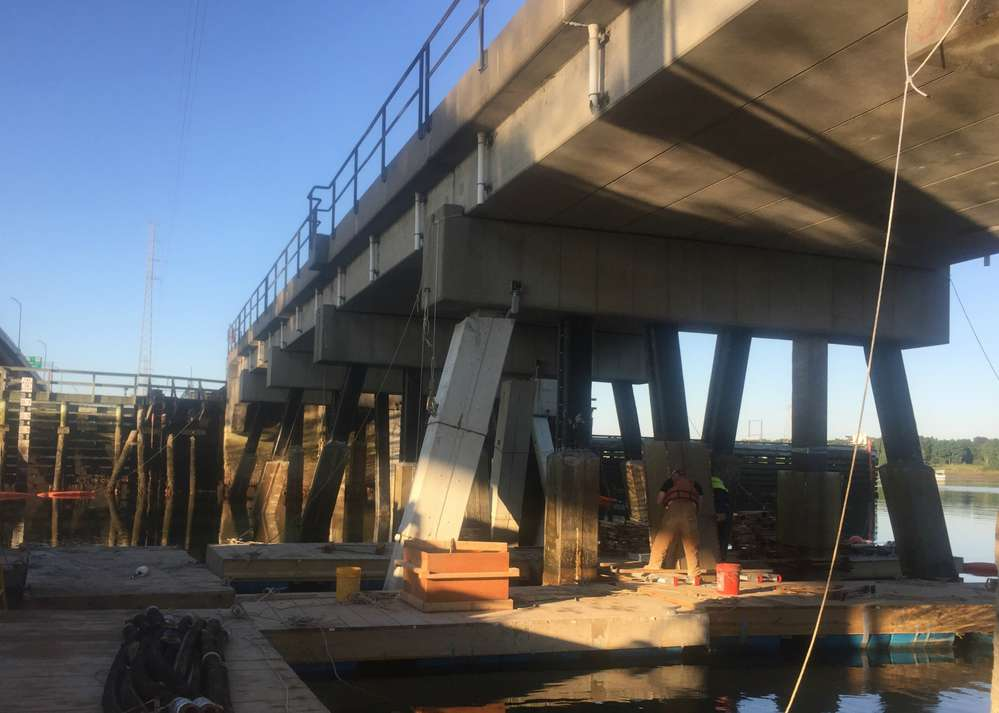 Work is continuing with concrete pile repair work within the navigational channel and north and south abutment repairs.