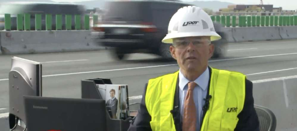Bracera moved his desk temporarily out to the work site to remind commuters that the highway is also the office and work place for DOT employees.