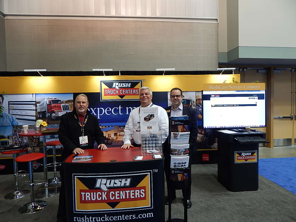(L-R): Steve Taylor, vice president medium duty sales; Brian Mulshine, director of operations and technology; and Michael Donohue, national account manager, all of Rush Enterprises, New Braunfels, Texas, attend the show.