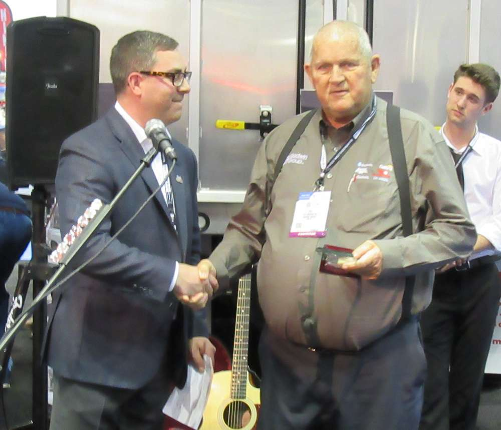 Robert Edmonds, president and COO of Drive Products Inc. honors industry leaders with Industry Pioneer & Icon Award. He presented the awards to Pat Godwin Sr. of Godwin Group (left photo) and  Bart Conry of Palfinger North America (right photo), who accepted the awards on behalf of Evan Corns and Fred Bongiovanni.