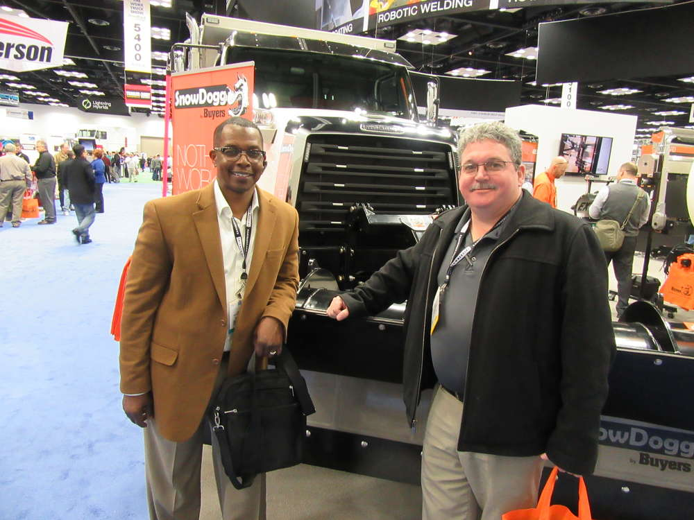 James Brown (L) and Curt Anderson, Cannon Truck Equipment, stop in at the Buyers Products booth to see the latest snow and ice removal equipment.