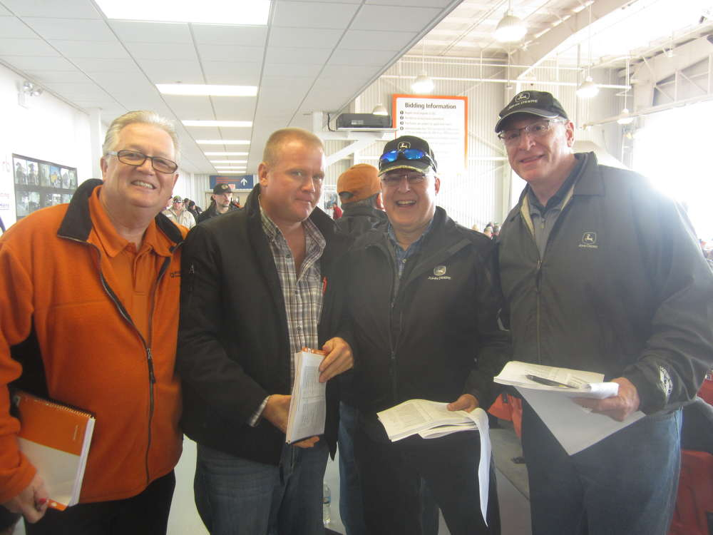 (L-R): Roger Martinez, Ritchie Bros. auctioneers, welcomes Ken Veen, LV Trucking; Tom Stern, sales manager, West Side Tractor Sales Co.; and Bob Bazzetta, used equipment manager, West Side Tractor Sales Co.