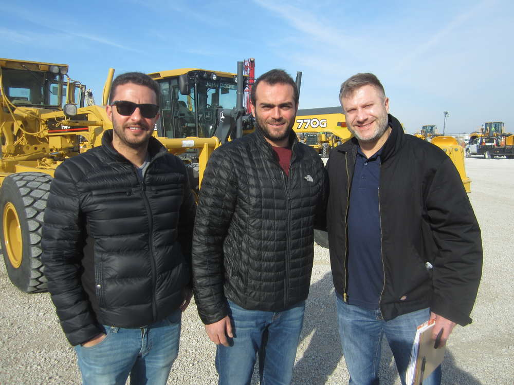 (L-R): Tareq Ghaboun and Abe Salameh, both of United Heavy Equipment Inc., speak with Jim King, used equipment manager, Aring Equipment Co. Inc.
