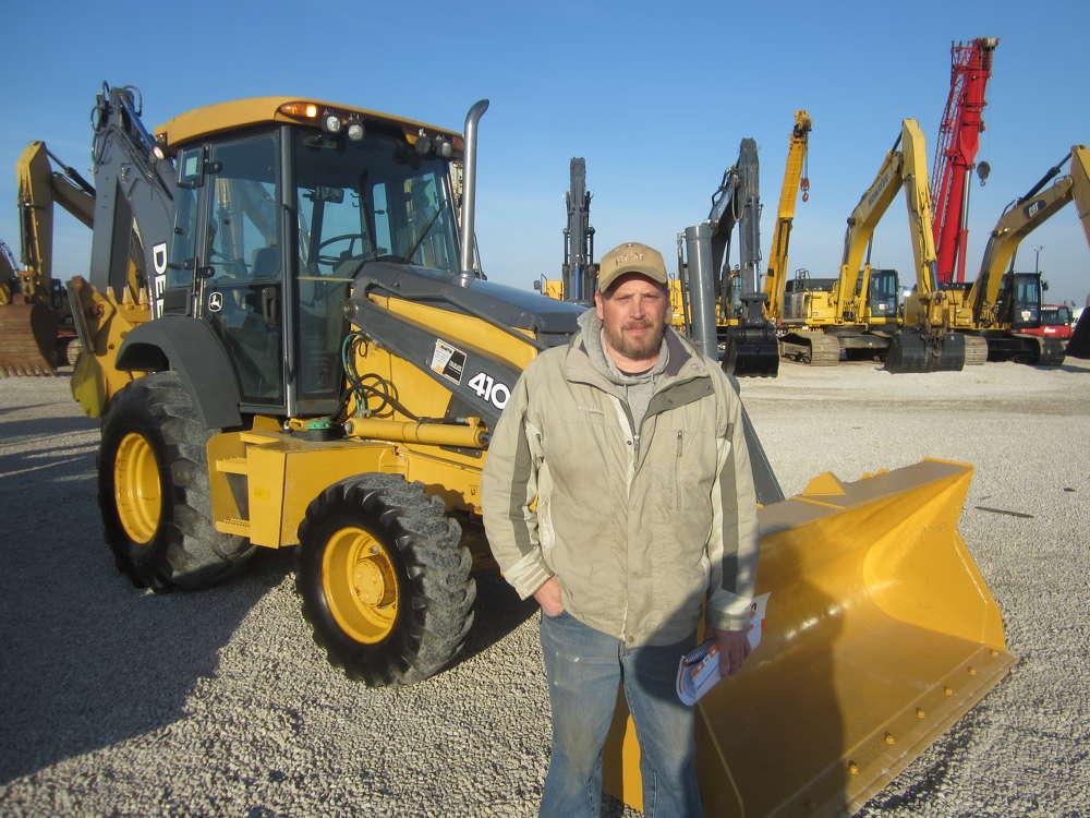 Bill Rollinger Jr. of M. Adams Equipment, Rockford, Ill., was the high bidder on this John Deere 410 loader backhoe.