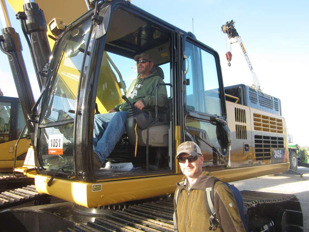 Matt (L) and Mark Schlegel, both of Carl Schlegel Inc., look over this Cat 345C excavator.