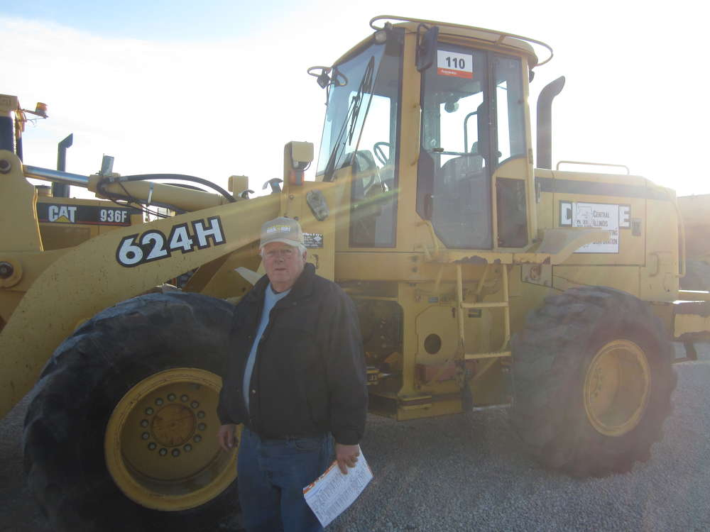 Less Hull, owner of Hulls 151 Implement, considers bidding on wheel loaders at the sale.