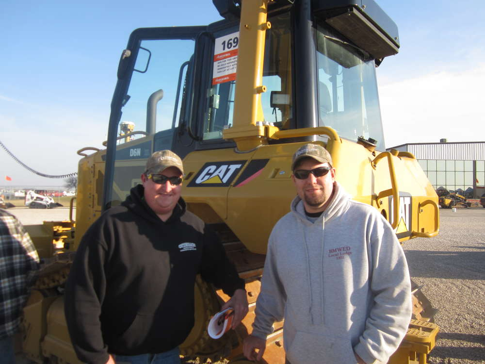 Caleb Otterbach (L) and Steve Brodko, both of Otterbach Demolition & Concrete Recycling, talk about this Cat D6N dozer.